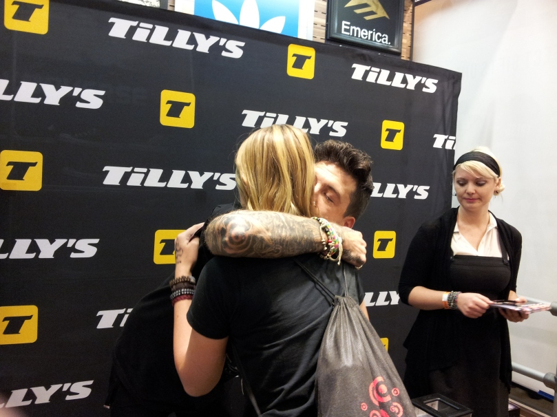 Austin Carlile hugs fan