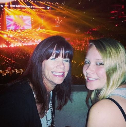 mom and daughter at concert