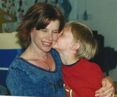 Mother-son-kiss