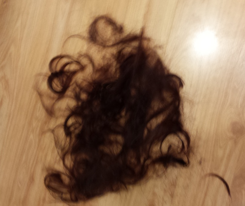 long-hair-cut-on-salon-floor