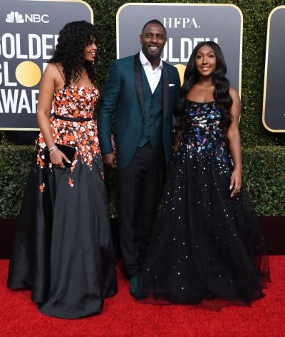 idris elba with daughter and fiance at golden globes red carpet